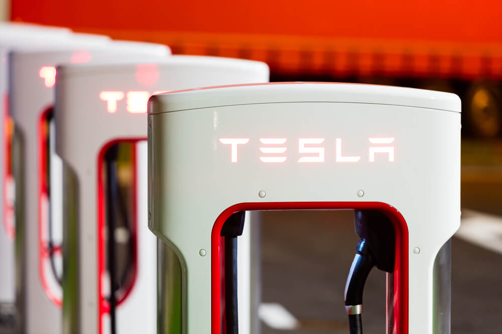 Closing Bell: Tesla Shares Score Big On Battery Announcement