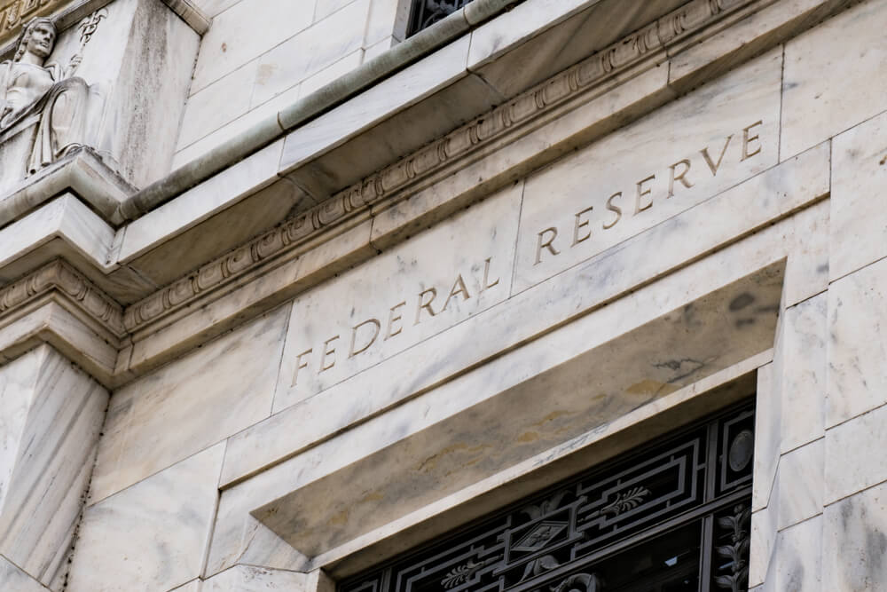 Fed Cuts Key Policy Interest Rate by Quarter-Point Amid 'Uncertainties'