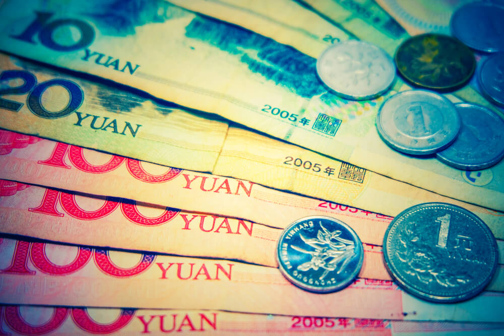 China Lowers Yuan in Risky Currency Manipulation Game
