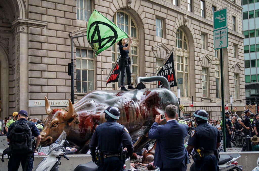 Liberal Protesters Force NYC to Move Wall Street's Iconic Charging Bull